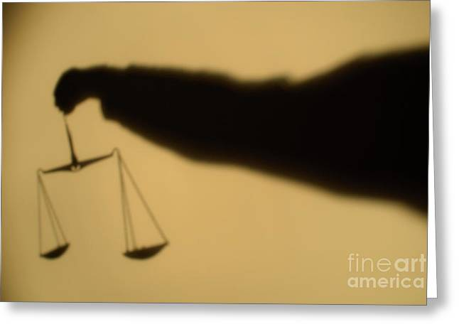 Moral Greeting Cards - Shadow of a persons arm holding out the Scales of Justice Greeting Card by Sami Sarkis