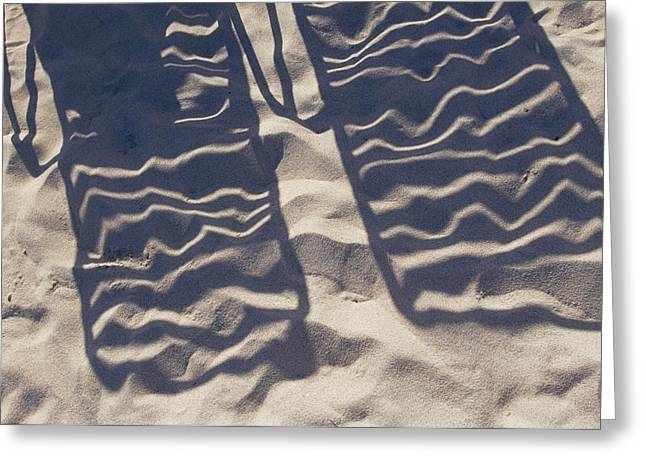 Benches And Chairs Greeting Cards - Shadows Of Lounge Chairs On The Beach Greeting Card by Todd Gipstein