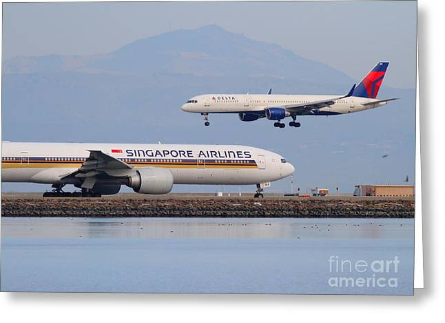 Airplane Landing Greeting Cards - Singapore Airlines And Delta Airlines Jet Airplane At San Francisco International Airport SFO Greeting Card by Wingsdomain Art and Photography