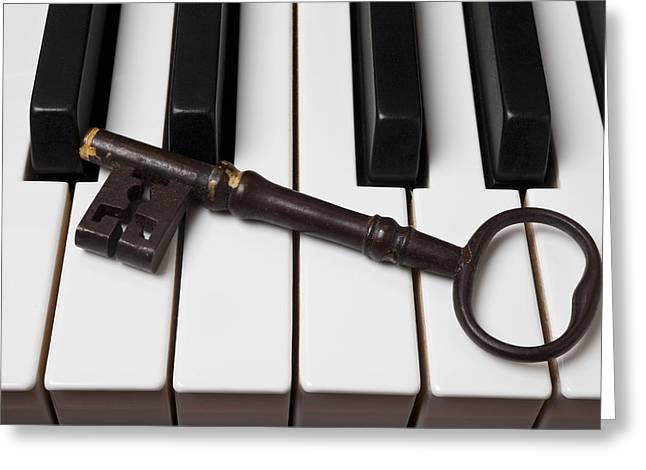 Piano Keys Greeting Cards - Skeleton key on piano keys Greeting Card by Garry Gay