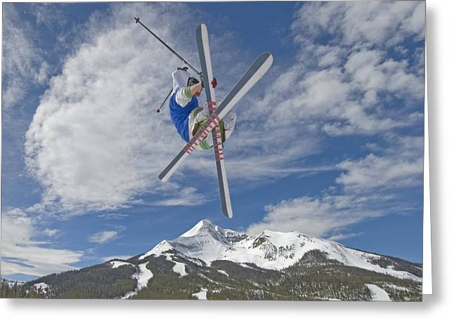 Ski Jumping Greeting Cards - Skiing Aerial Maneuvers Off A Jump Greeting Card by Gordon Wiltsie