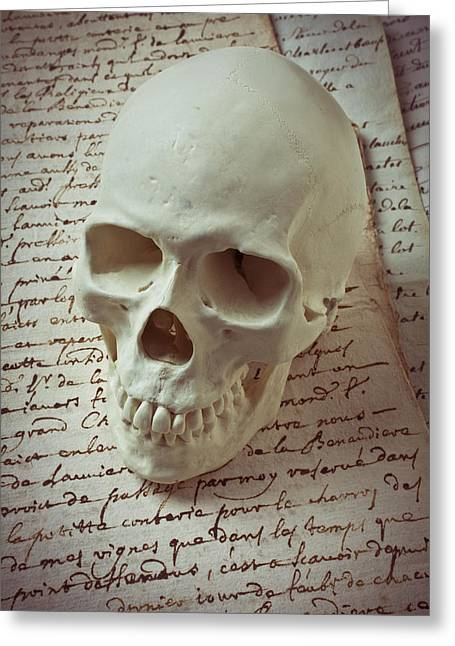 Skulls Photographs Greeting Cards - Skull on old letters Greeting Card by Garry Gay