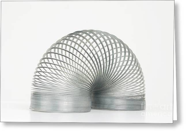 Coil Spring Greeting Cards - Slinky Toy Greeting Card by Photo Researchers, Inc.
