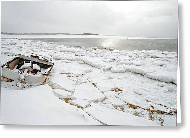 Town Pier Greeting Cards - Small boat sits on ice chuncks in Wellfleet on Cape Cod in winte Greeting Card by Matt Suess