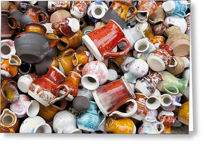 Pottery Pitcher Greeting Cards - Small ceramic  jugs and cups macro Greeting Card by Aleksandr Volkov