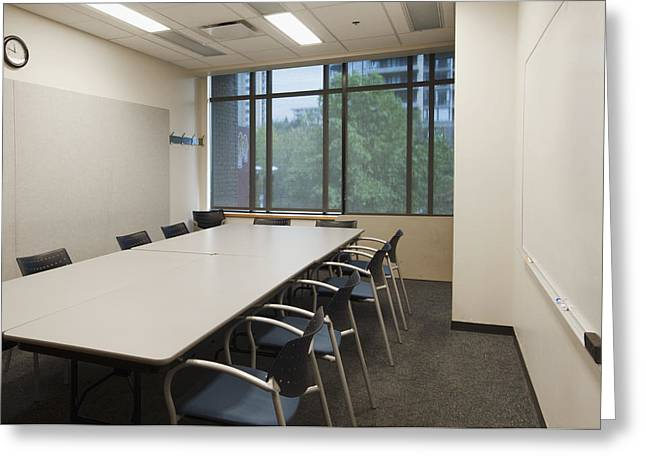 Empty Chairs Greeting Cards - Small Empty Boardroom With A Long Greeting Card by Marlene Ford