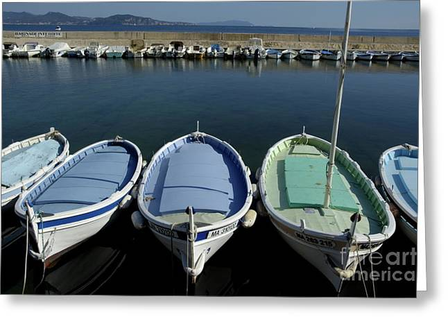 Boats In Harbor Greeting Cards - Small fishing boats lined up in a near row Greeting Card by Sami Sarkis