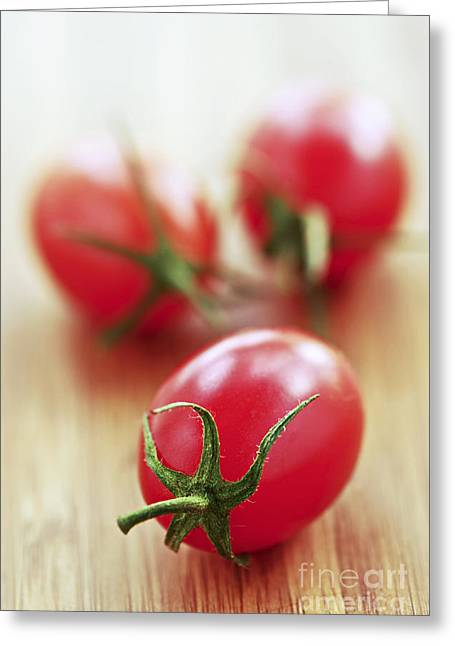 Organic Photographs Greeting Cards - Small tomatoes Greeting Card by Elena Elisseeva