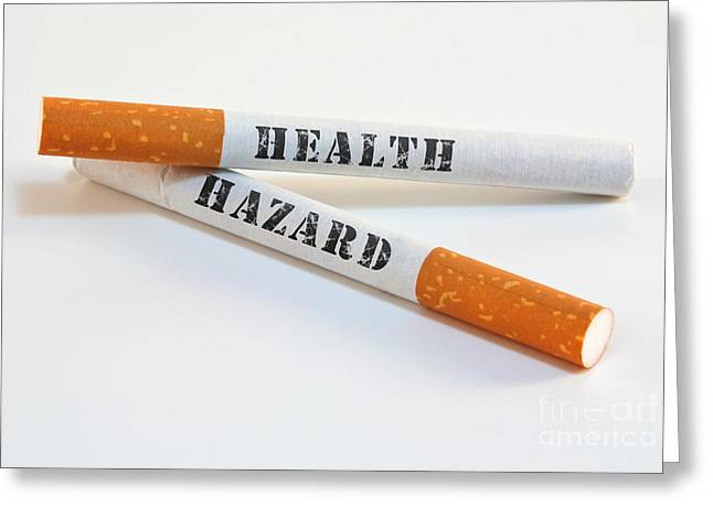 Smoking Greeting Cards - Smoking is a health hazard Greeting Card by Blink Images