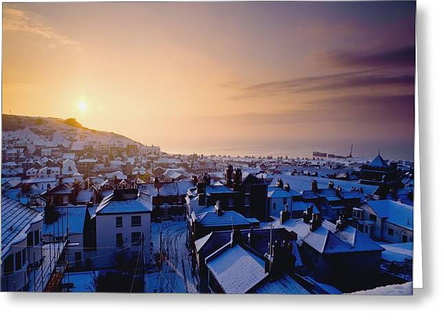 Snowy Evening Greeting Cards - Snow Covered Rooftops Of Hastings Greeting Card by Axiom Photographic