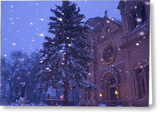 Streetlight Greeting Cards - Snow Falls On A City Scene Greeting Card by Ralph Lee Hopkins