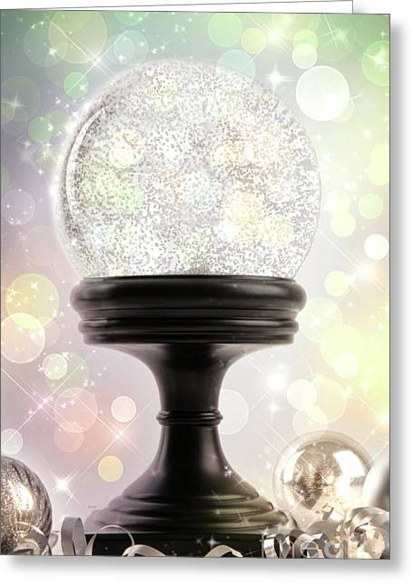 Snow Globe Greeting Cards - Snowglobe with ornaments against colored background Greeting Card by Sandra Cunningham