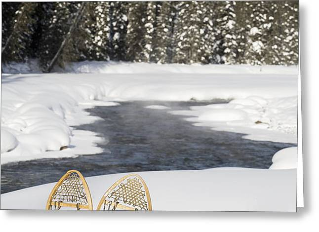 Snowshoes By Snowy Lake Lake Louise Greeting Card by Michael Interisano