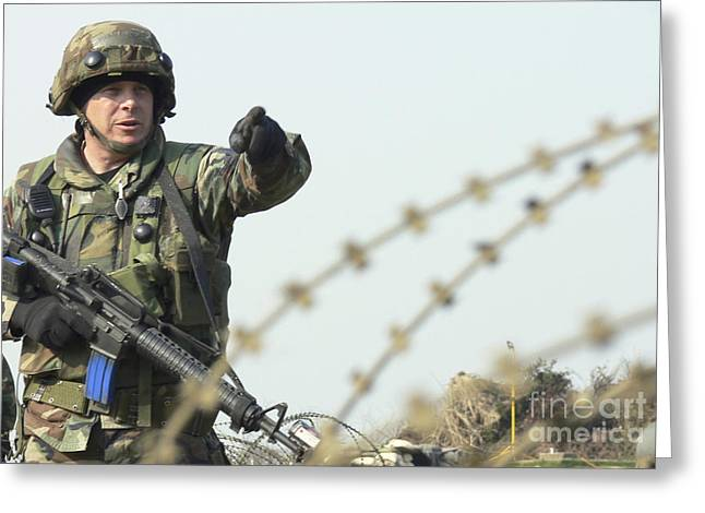 Soldier Calls Out Approaching Locals Greeting Card by Stocktrek Images