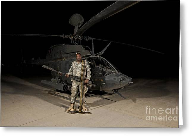 Holding Gun Greeting Cards - Soldier Holding A .50 Caliber Machine Greeting Card by Terry Moore