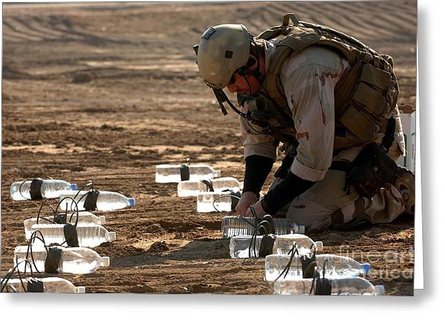 Bottle Of Colors Greeting Cards - Soldier Links Explosives Together Greeting Card by Stocktrek Images