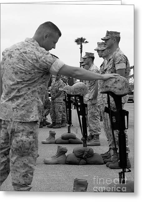 Fallen Soldiers Greeting Cards - Soldier Pays His Respect To Fallen Greeting Card by Stocktrek Images