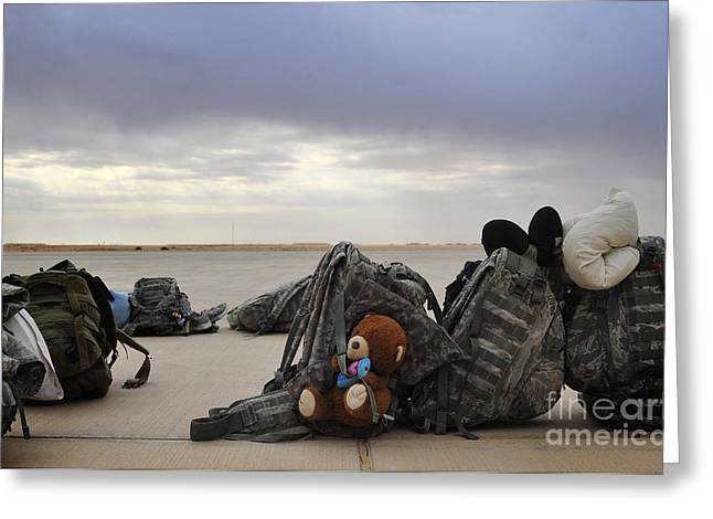 Iraq Photographs Greeting Cards - Soldiers Backpacks On The Flight Line Greeting Card by Stocktrek Images