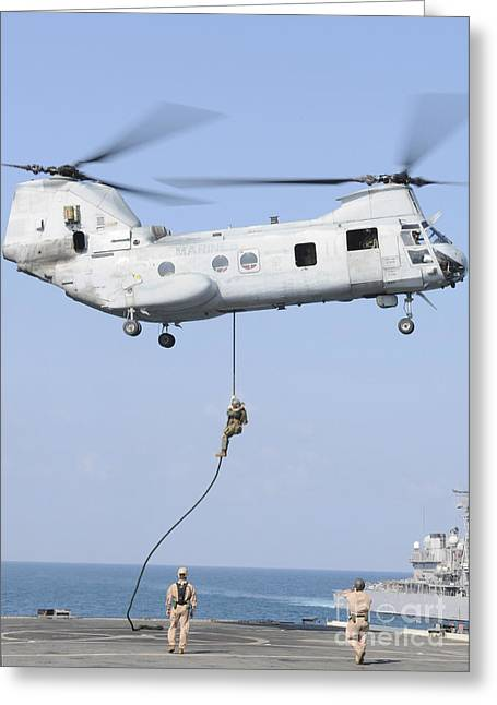 Fast Rope Greeting Cards - Soldiers Fast Rope From A Ch-46e Sea Greeting Card by Stocktrek Images
