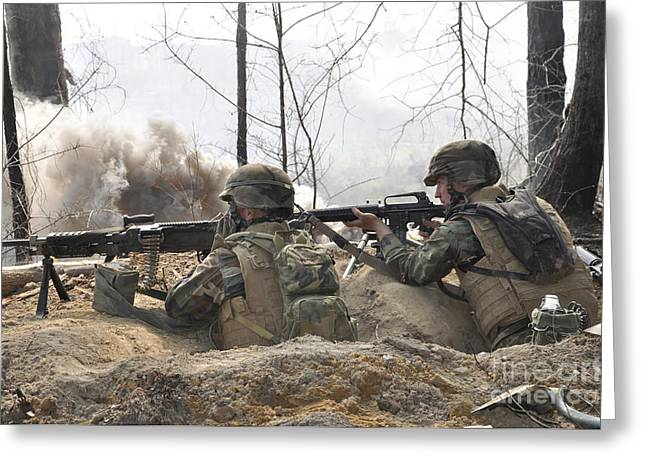 Bipod Greeting Cards - Soldiers Fire Their Weapons From A Fox Greeting Card by Stocktrek Images