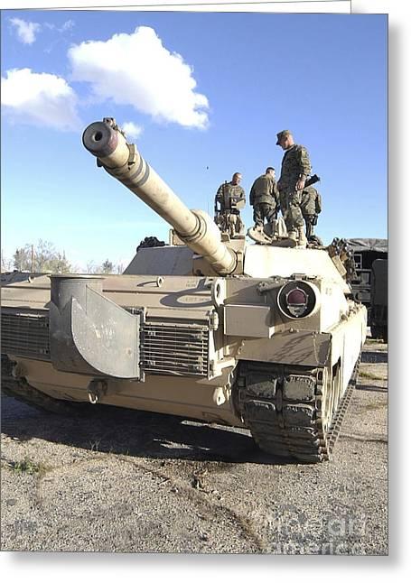 Soldiers Get Their Battletank Ready Greeting Card by Stocktrek Images
