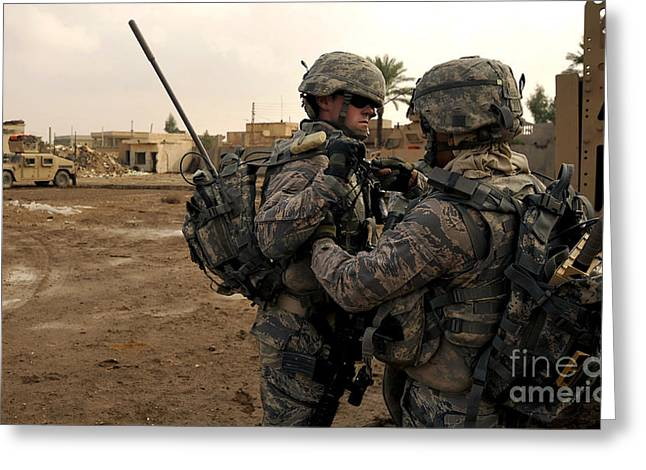 Iraq Photographs Greeting Cards - Soldiers Help One Another Greeting Card by Stocktrek Images