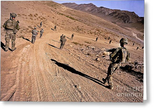Zabul Greeting Cards - Soldiers Patrol To A Village Greeting Card by Stocktrek Images
