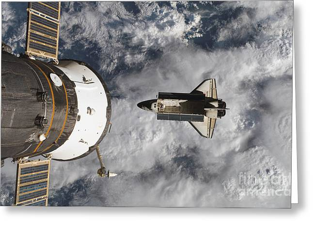 Atlantis Greeting Cards - Space Shuttle Atlantis And The Docked Greeting Card by Stocktrek Images
