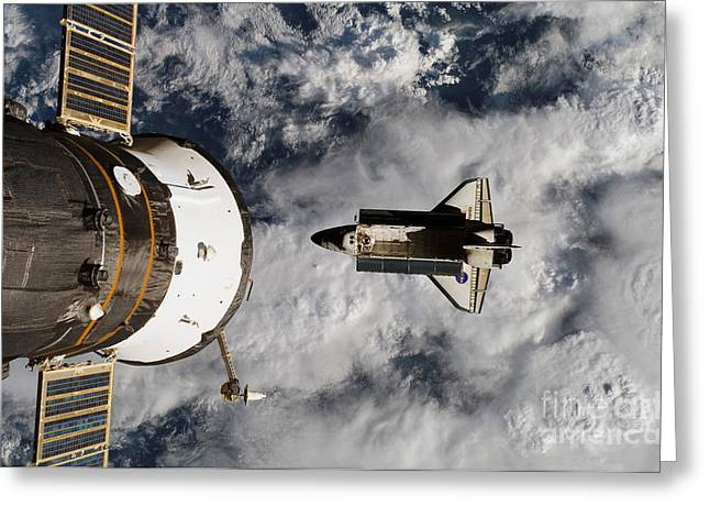 Atlantis Greeting Cards - Space Shuttle Atlantis Below Iss Greeting Card by Science Source