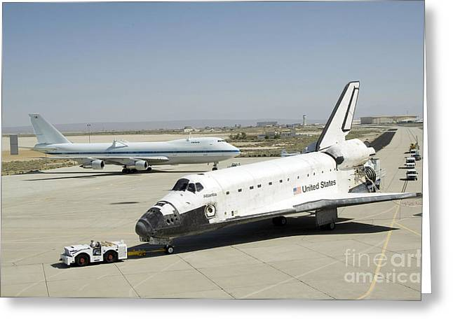 Atlantis Greeting Cards - Space Shuttle Atlantis Is Towed Greeting Card by Stocktrek Images
