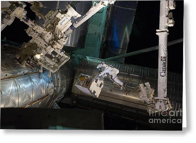 Iss Greeting Cards - Spacewalk On Iss Greeting Card by NASA/Science Source