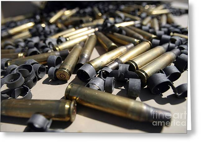 .50 Caliber Greeting Cards - Spent Brass And Disintegrated Links Greeting Card by Stocktrek Images