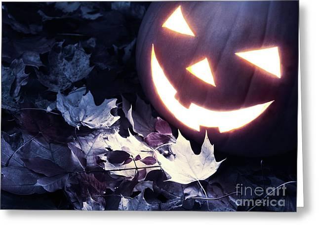 Jackolanterns Greeting Cards - Spooky Jack-o-lantern on Fallen Leaves Greeting Card by Oleksiy Maksymenko