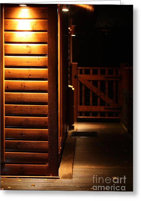 Black Lodge Photographs Greeting Cards - Spot light lodge at night with space for sign Greeting Card by Simon Bratt Photography LRPS