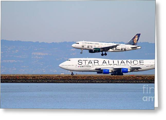 Intransit Greeting Cards - Star Alliance Airlines And Frontier Airlines Jet Airplanes At San Francisco Airport . Long Cut Greeting Card by Wingsdomain Art and Photography