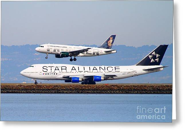 Star Alliance Airline Photographs Greeting Cards - Star Alliance Airlines And Frontier Airlines Jet Airplanes At San Francisco International Airport Greeting Card by Wingsdomain Art and Photography