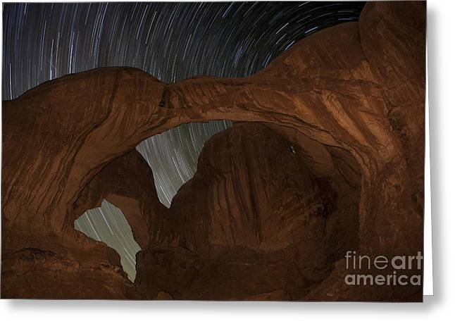 Stars Trail Greeting Cards - Star trails at Double Arch Greeting Card by Keith Kapple
