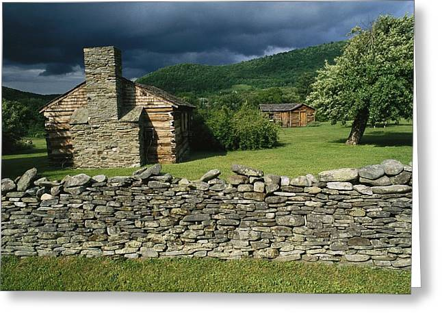 Lawns Fields Greeting Cards - Storm Clouds Form Above Log Buildings Greeting Card by Raymond Gehman