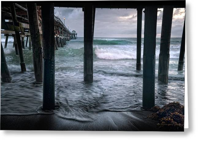 Stormy Pier Greeting Card by Gary Zuercher