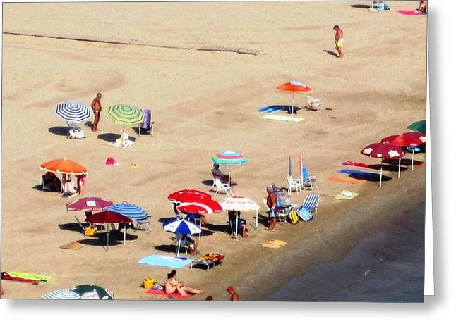 Sun Bathers And Beach Umbrellas In Peniscola Spain Greeting Card by John Shiron