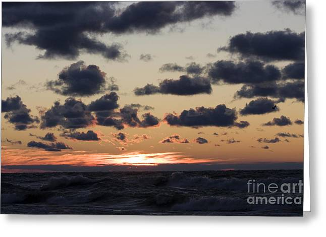 Sun setting with dramatic clouds over Lake Michigan Greeting Card by Christopher Purcell