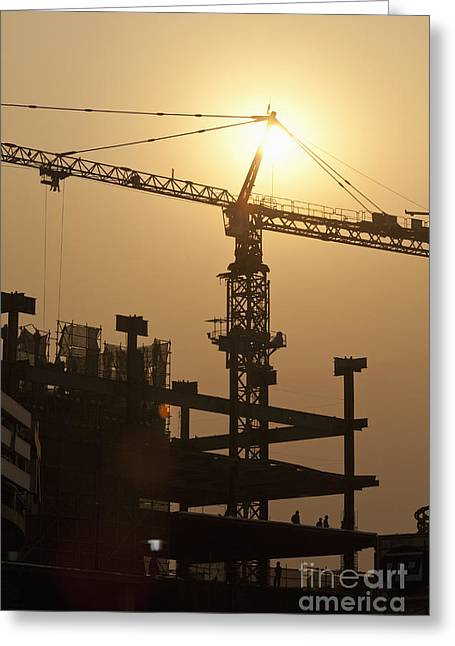 Tower Crane Greeting Cards - Sun Shining Behind a Construction Crane Greeting Card by Shannon Fagan