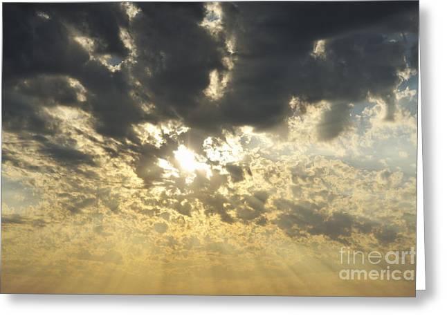 Sun Shining Through Clouds At Sunset Greeting Card by Sami Sarkis