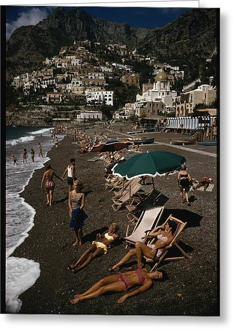 Sunbathing Greeting Cards - Sunbathers Lounge On A Pebbled Beach Greeting Card by Luis Marden