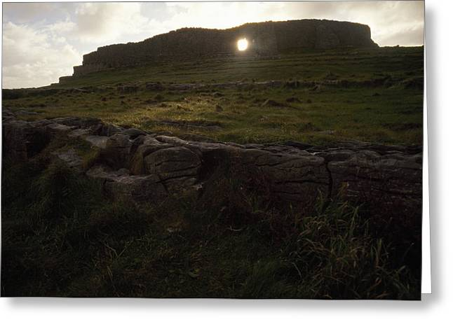 Inishmore Greeting Cards - Sunlight Glows Through An Opening Greeting Card by Justin Guariglia