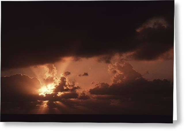 Clouds And Sun Greeting Cards - Sunset And Clouds Over Water Greeting Card by Ira Block