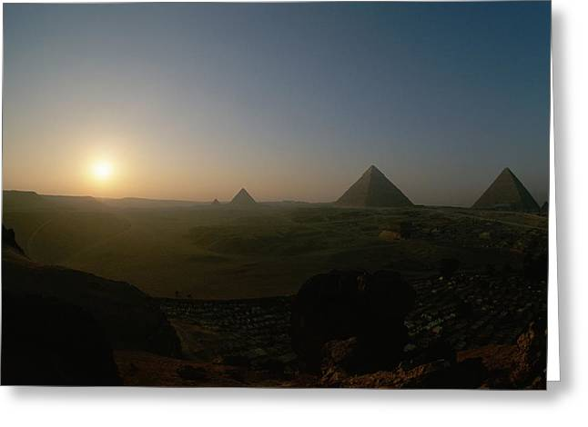 Pyramids Greeting Cards - Sunset At Giza. Pyramids From Left Greeting Card by Kenneth Garrett