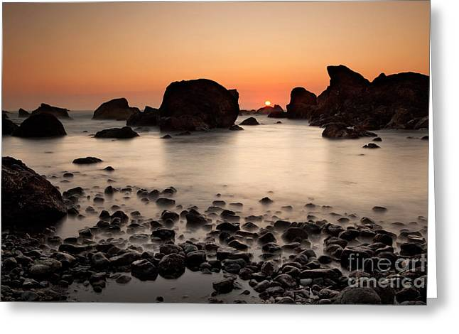 Turbulent Skies Photographs Greeting Cards - Sunset on a rock Greeting Card by Keith Kapple