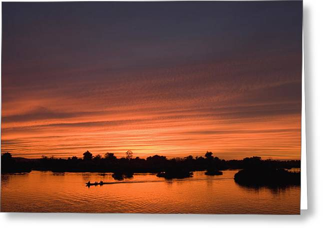 Boats In Reflecting Water Photographs Greeting Cards - Sunset Over River Greeting Card by Axiom Photographic
