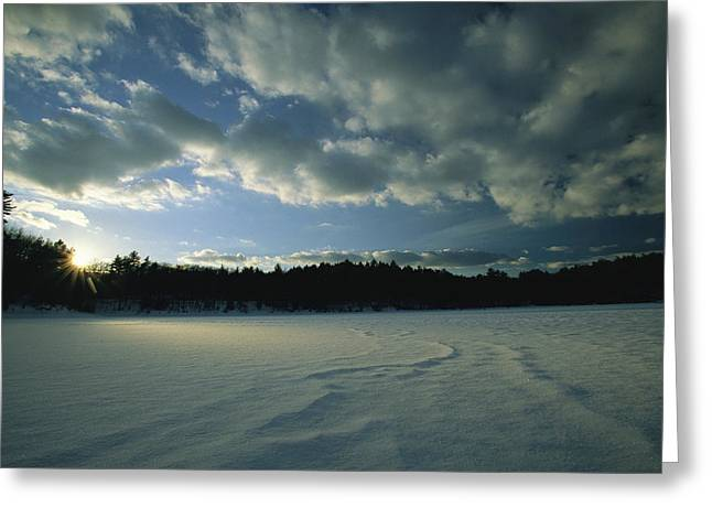 Sunset Viewed From The Frozen Surface Greeting Card by Tim Laman